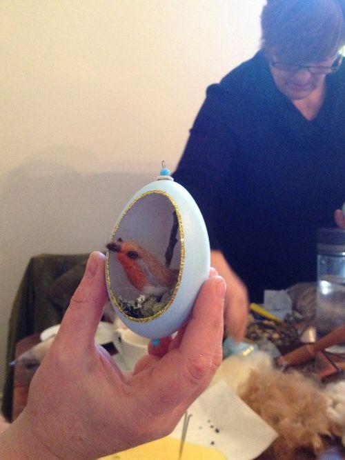 Robin in egg